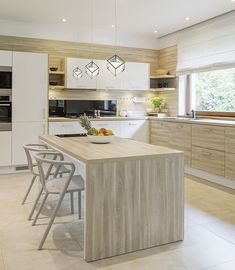 A contemporary kitchen with beautiful single pendants above the island. Floor Lamp, Contemporary Kitchen, Kitchen Design, Kitchen Decor, Flooring, Lighting, Kitchen Trends, Kitchen, Home Decor