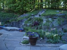 Retaining walls made from artificial rock panels by Rockscapes of Canada inc.