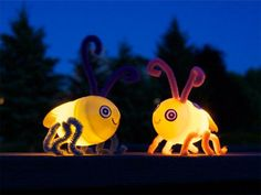 These fireflies are super easy to make. Just pop a flameless LED tealight into a plastic Easter egg. You don't even need glue! Poke holes through the egg with a thumbtack to insert the pipe cleaners. The eyes are drawn onto white sticky labels, and the wings are silver duct tape. Quick, easy, and totally cute!