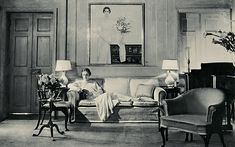 In 1934, Bobsy Goodspeed, seated beneath a portrait of her by Bernard Boutet de Monvel, relaxes at her lush Lincoln Park apartment; the architect David Adler designed the space.
