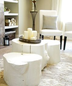 white tree trunk table base with wicker basket and candles besid white accent chairs