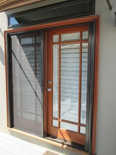 Double Door Retractable StowAway Screen installed on these beautiful french doors in Orange County, California. Check out the # 1 Retractable Screen Door called StowAway. In this picture we show a Bronze Retractable Screen with a slow kid safe close as well as black fiberglass mesh.   Looking for the best screen on the market - You Just Found It!