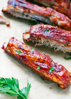 Oven Baked St Louis Style Ribs Recipe - made in the oven, covered in bbq sauce, these ribs are so tender, sticky and delicious!