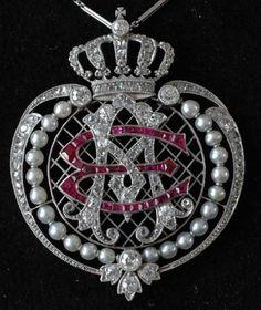 Platinum pendant with the monogram of Queen Emma Adelheid. Diamonds, Pearls and Rubies. c 1900.