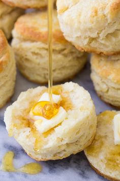 The BEST biscuit recipe! These homemade biscuits are fluffy and tender with lots of flaky layers. So easy to make, using either buttermilk or milk. They're perfect for slathering with butter and honey! Real Food Recipes, Baking Recipes, Dessert Recipes, Yummy Food, Desserts, Bread Recipes, Kitchen Recipes, Easy Recipes, Brunch Recipes