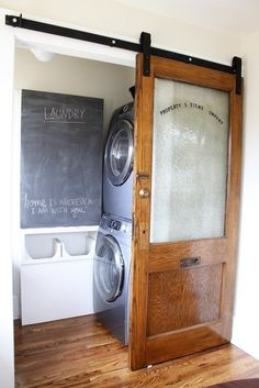 DIY sliding laundry room door. Pretty much the best door ever for our kitchen pantry/laundry! Wonder if our washer/dryer will stack well like this to open up our laundry chute!