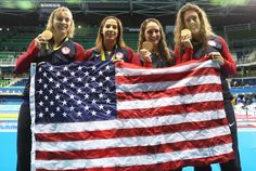 Katie Ledecky, Maya Dirado, Leah Smith and Allison Schimdt of United States pose with their Gold medals from the Women's 4 x 20m Freestyle Relay on Day 5 of the Rio 2016 Olympic Games at the Olympic Aquatics Stadium in Rio de Janeiro on August 10, 2016.
