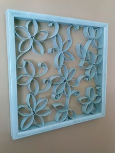 I had the frame, toilet paper rolls cut into flowers, and stems, glued together, and spray painted turquoise.