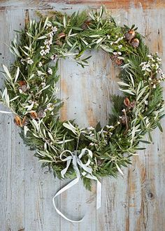 Fresh sprigs of rosemary, thyme and other green herbs can be woven into a handmade wreath for a fragrant touch | Home Beautiful Magazine Australia