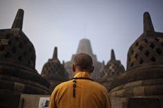 A Buddhist monk prays at Borobudur temple on Vesak Day, commonly known as 'Buddha's birthday', at the Borobudur Mahayana Buddhist monument on May 17. (Ulet Ifansasti/Getty Images) #