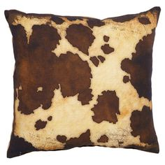 Add a touch of rustic appeal to your sofa, chaise, or bed with this handsome burlap and cotton pillow, showcasing a multicolor cowhide-inspired motif.