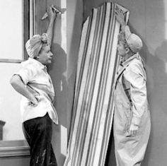 Wallpapering the bedroom with Lucy and Ethel