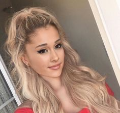 New photo of Ariana Grande with curly light blonde long hair.:).