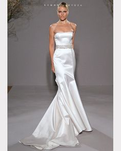 Legends by Ramona Keveza's beautiful strapless gown made of silk satin features a straight neckline and a fluted shaped skirt with a chapel length train. This gown in shown with a beaded belt. Available at Brides By The Falls in Chagrin Falls, Ohio. Ramona Keveza, Strapless Gown, Designer Wedding Dresses, Wedding Attire, Silk Satin, Dress Collection, Silk Dress, Bridal Gowns, One Shoulder Wedding Dress