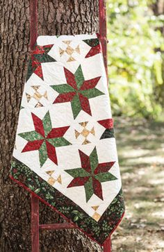 It's never too early to start on Christmas gifts. This small quilt goes together quickly, thanks to the super fast triangle-square technique.