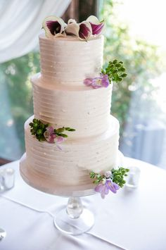 simple tiered wedding cake with floral topper