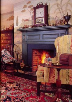 Such a warm inviting room - WELCOME!  dark blue fireplace mantle, gold wing chair, clock, red oriental rug, Windsor chair