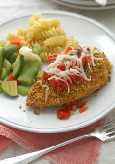Chicken Parmigiana with Fresh Tomato Sauce -- Ready for the dinner table in just 30 minutes, serve this delicious recipe with hot cooked rotini and steamed vegetables to round out the meal.