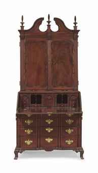 A CHIPPENDALE CARVED MAHOGANY BLOCK-FRONT DESK-AND-BOOKCASE