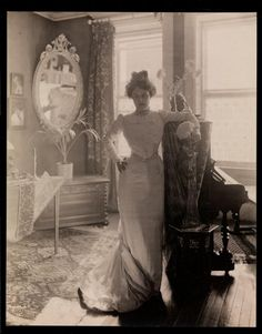 victorian lady posing with beautiful living room and furniture in the background