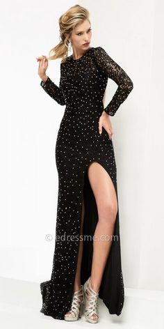 The Starry Night Lace Open Back Evening Dress by Jasz Couture has all the right elements to make you stand out and look incredible on your special night. This unique style features a round neckline, long fitted sleeves and a keyhole open back. The column silhouette also includes beautiful lace fabric, rhinestone embellishments and a thigh high slit with a short sweep train. #edressme