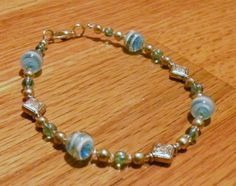 Aqua Blue and White Swirl Glass and Silver Bracelet by TriannasTreasures