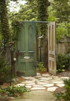 Create a secret garden by replacing your garden gate with oversized doors! | Living the Country Life | www.livingthecoun...