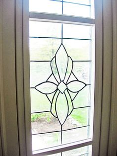 making faux stained glass or beveled glass windows! she even says that it's completely able to be temporary (just peels right off). totally gonna start thinking about how i would want to do this, but it would fit perfect on the windows next to our fireplace!!