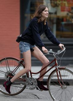 Victorian Inspiration: Chelsea Boots, a Fall Must Have -- Alexa Chung on her bicycle, with #cutoffshorts and #chelseaboots ... adorable! Behlor