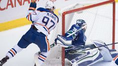 Cam Talbot made 26 saves and Connor McDavid scored on a breakaway in the second period as the Edmonton Oilers blanked the Vancouver Canucks 2-0 on Friday night at Rogers Arena.