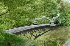 A team of engineers and designers want to change the 3-D printing game by making a bridge appear out of thin air, using a team of robotic printers.