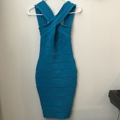 Blue bandage dress No tags but never worn. New condition. Very body flattering. Apartment Dresses