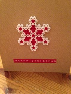 Lovely shabby chic Nordic Christmas themed card.    Handmade with love, this retro looking card has a Hama bead white & red snowflake on it