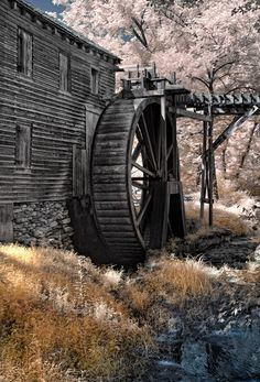 Future rustic looking mill with water wheel on our stream on the future property