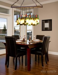 Recycled Wine Bottle Chandelier.  What a great way to reuse these! I love how the light peeks through the labels.