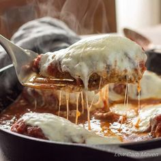 This low carb Chicken Parmesan tastes like it came from a restaurant. It cooks in a skillet and the low carb breading stays crispy and delicious.
