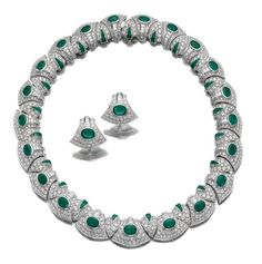 EMERALD AND DIAMOND PARURE, BULGARI. Comprising: a necklace designed as a series of fancy links set with oval and calibré-cut emeralds and brilliant-cut diamonds, length approximately 430mm; together with a bracelet and a pair of ear clips en suite, bracelet length approximately 190mm, each piece signed Bulgari [Bracelet not illustrated]