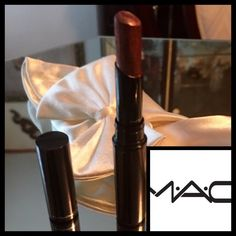 🆕MAC❤️Most Wanted❤️Disc.❤️Slimshine Lipstick MAC 'Slimshine' Lipstick❤️MAC 🌹DISCONTINUED🌹the ENTIRE Slimshine Line❤️Rare Hard To Find❤️Most Wanted❤️is a very dark burgundy with red and gold shimmer–making it a beautiful bronze❤️sleek casing on the go ❤️swatched❤️sitting on my vanity❤️!!❤️Its beautiful shimmer❤️needs a new home❤️🚫trades🚫💄Bundle Discounts💄please submit all offers via offer button❤️Price on this is firm❤️thank You💋 MAC Cosmetics Makeup Lipstick