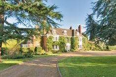 Price: $7,000,000     Location: Headley, United Kingdom   Type of Home: Equestrian     This 11-bedroom country property just over 20 miles from central London was built in 1903 and includes 10 acres of land with extensive equestrian facilities, a heated swimming pool and a floodlit tennis court