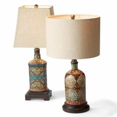 We love the richness of these bottle shaped Tirano Lamps which are hand-painted in beautiful designs on a dark wooden base. A great way to light up a reading nook and show off a one of a kind decorative piece!