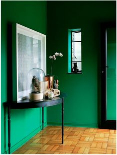 This verdant green hallway is a lesson in making an entrance. How could you not love coming home to a space like this every day? We're hardwired to find green soothing and uplifting, as it triggers the feeling of being surrounded by nature, so it makes sense to have this shade envelop you from the moment you step through the door. Green with envy, indeed.  #refinery29 http://www.refinery29.uk/emerald-green-interiors-tips#slide-6