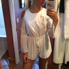 White long sleeve crotchet romper White long sleeve romper. Cutout shoulders with crochet detail. I'm almost 5'9 and I'm too tall for it. It's AUS size 10 so it's a Medium. Brand new with tags, never worn. Ordered from Hello Molly, brand is West End Doll, not FP. Cheaper on Ⓜ️ Free People Tops