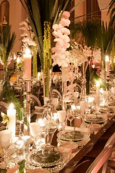 Love the tablescape. Big center pieces, beautiful lighting, no linens.