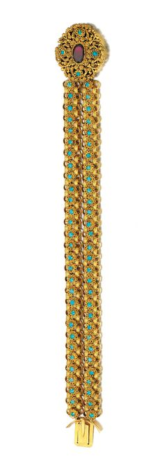 GARNET AND TURQUOISE BRACELET, EARLY 19TH CENTURY.  Composed of cannetille work links and plaque set with an oval foil backed garnet and cabochon turquoises, length approximately 195mm.