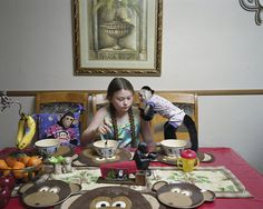 Pin for Later: This Amelia and the Animals Photo Series Demonstrates a True Mother-Daughter Bond  Robin Schwartz, Breakfast Talk with Rosie, 2011, from Amelia and the Animals (Aperture, 2014)