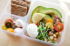 Chickpea salad, hard boiled egg, avocado, heirloom tomatoes, mozzarella balls, wasa crackers and lemon.