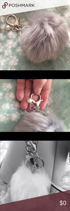 """🐰🌿 NEW FAUX FUR KEYCHAIN PURSE CHARM PURSE CHARM FAUX FUR POM POM WITH SILVER HARDWARE LOOKS SUPER CUTE AND NICE TO KNOW WHERE KEYS ARE . APPROX SIZE 3"""". LIGHT GRAY.  FREE WITH PURCHASE ! Accessories"""