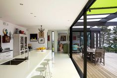 The Box Living home is filled with colourful artworks. In the kitchen, white rubber flooring from the USA was installed. Outdoor Shelves, Boxing Live, Container House Design, Container Houses, Latest House Designs, Life Space, Interior Architecture, Container Architecture, Island Life