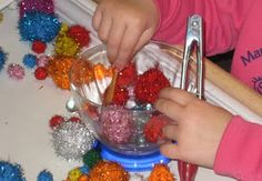Open ended pompom activity to help with fine motor skills