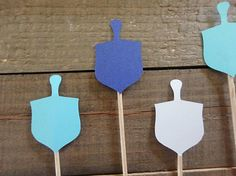12 Dreidel Cupcake Toppers Choose your color Dreidel Size: 1 Inch x 1.5 Inches Get Creative for your parties and use these toppers for ... Cupcake Toppers Cake Toppers Brownie Toppers Party Food Toppers Finger Food Toppers Dessert Toppers And much more Cupcake toppers are double
